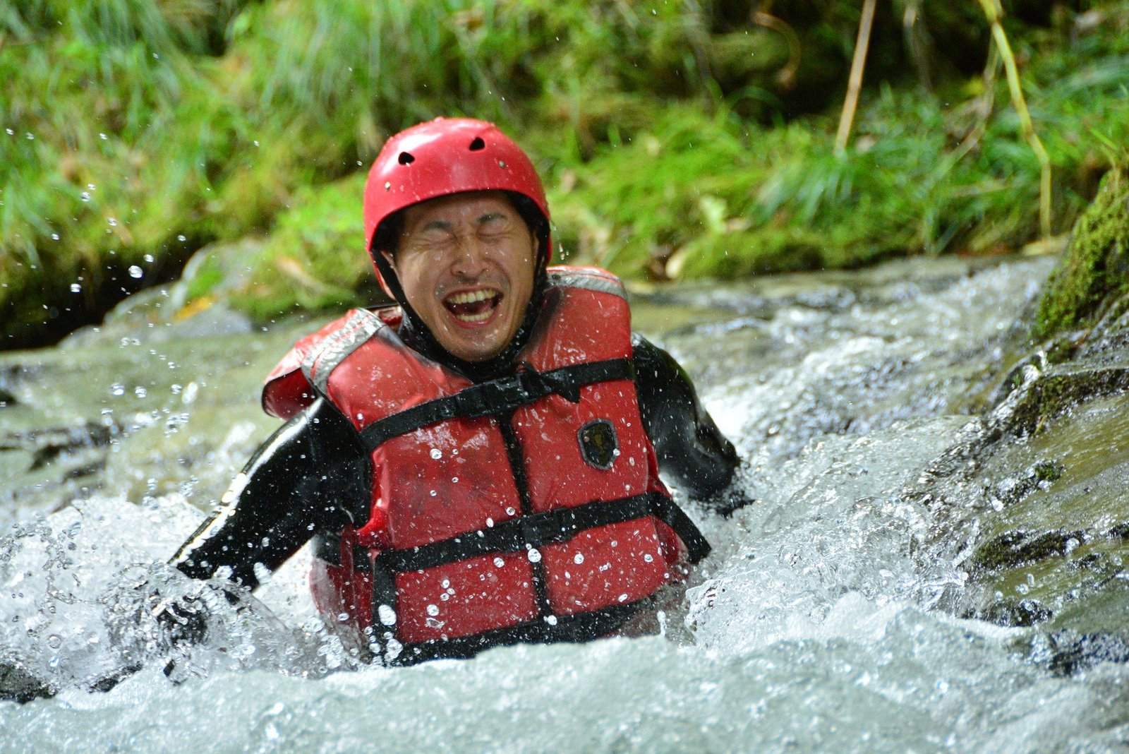 A man playing happily in the Shiribetsu river, Hokkaido