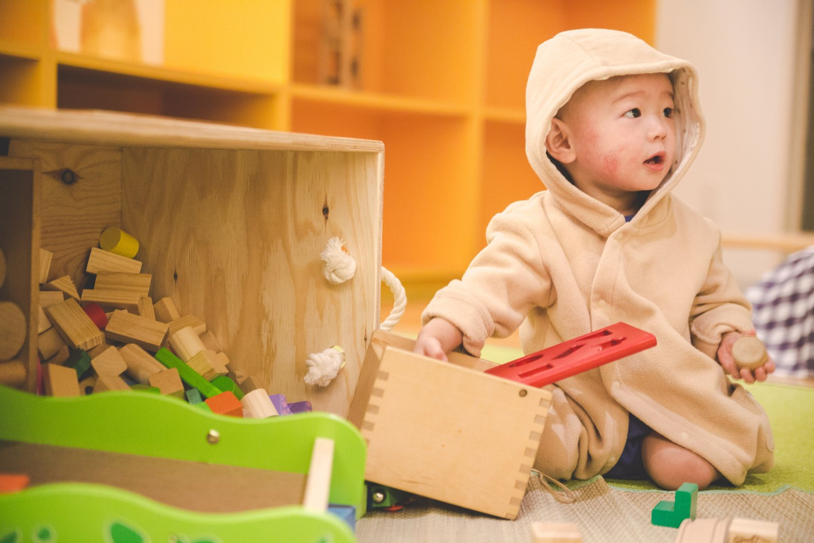 `toddler playing at Niseko Kids Club