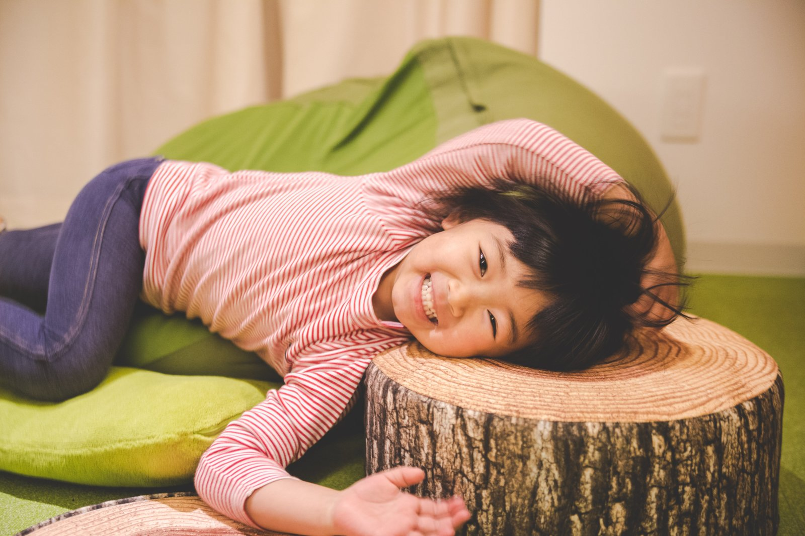 A girl smiling at Niseko Kids Club daycare