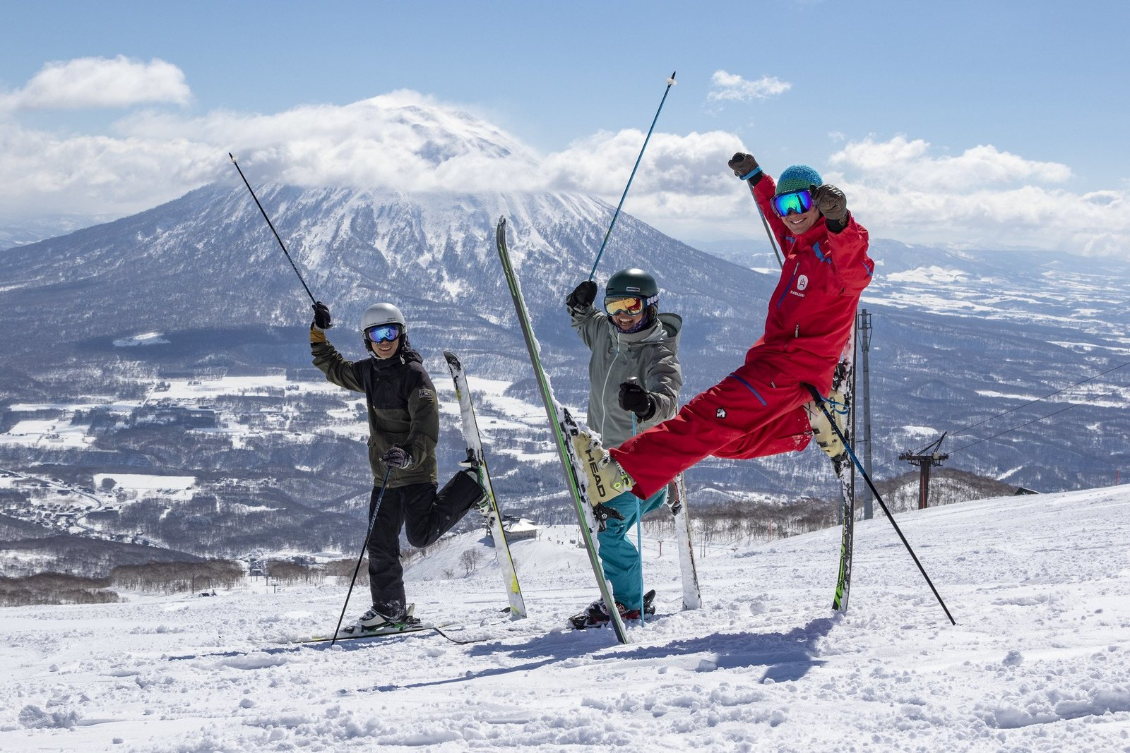 three skiers having fun on slope