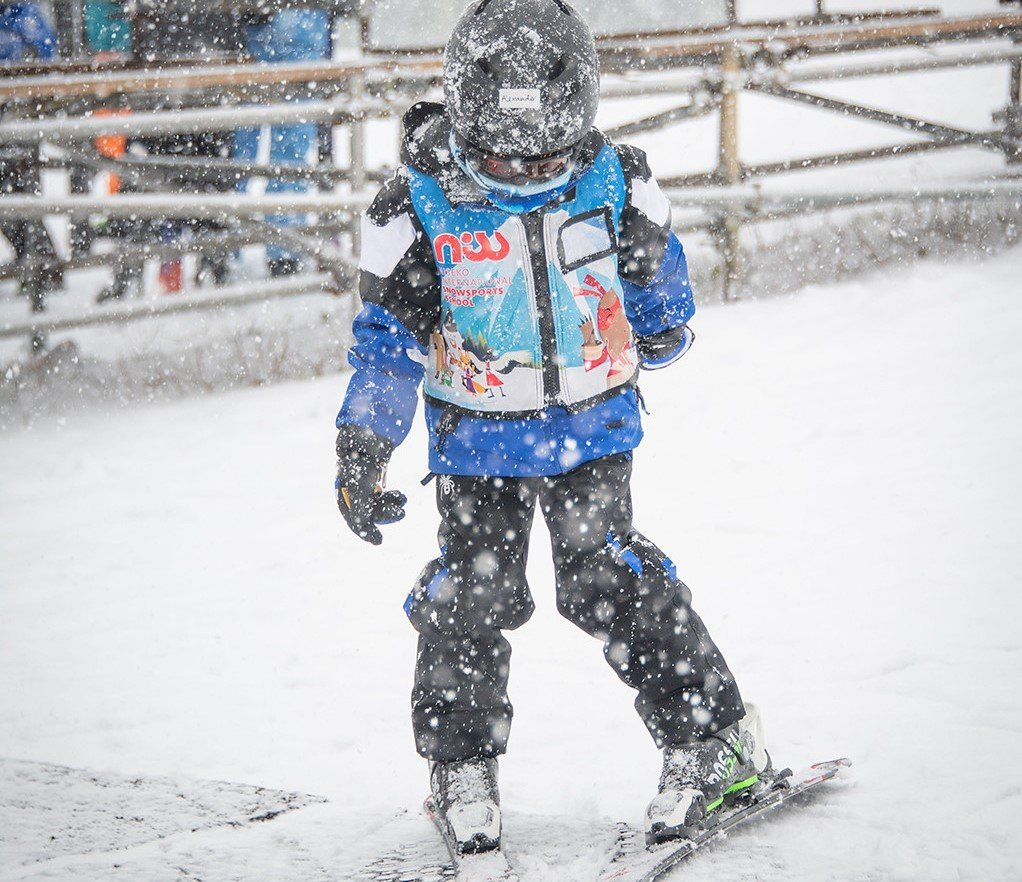 Alexander (Buddy) practice skiing in snow shower condition with NISS on beginner magic carpet