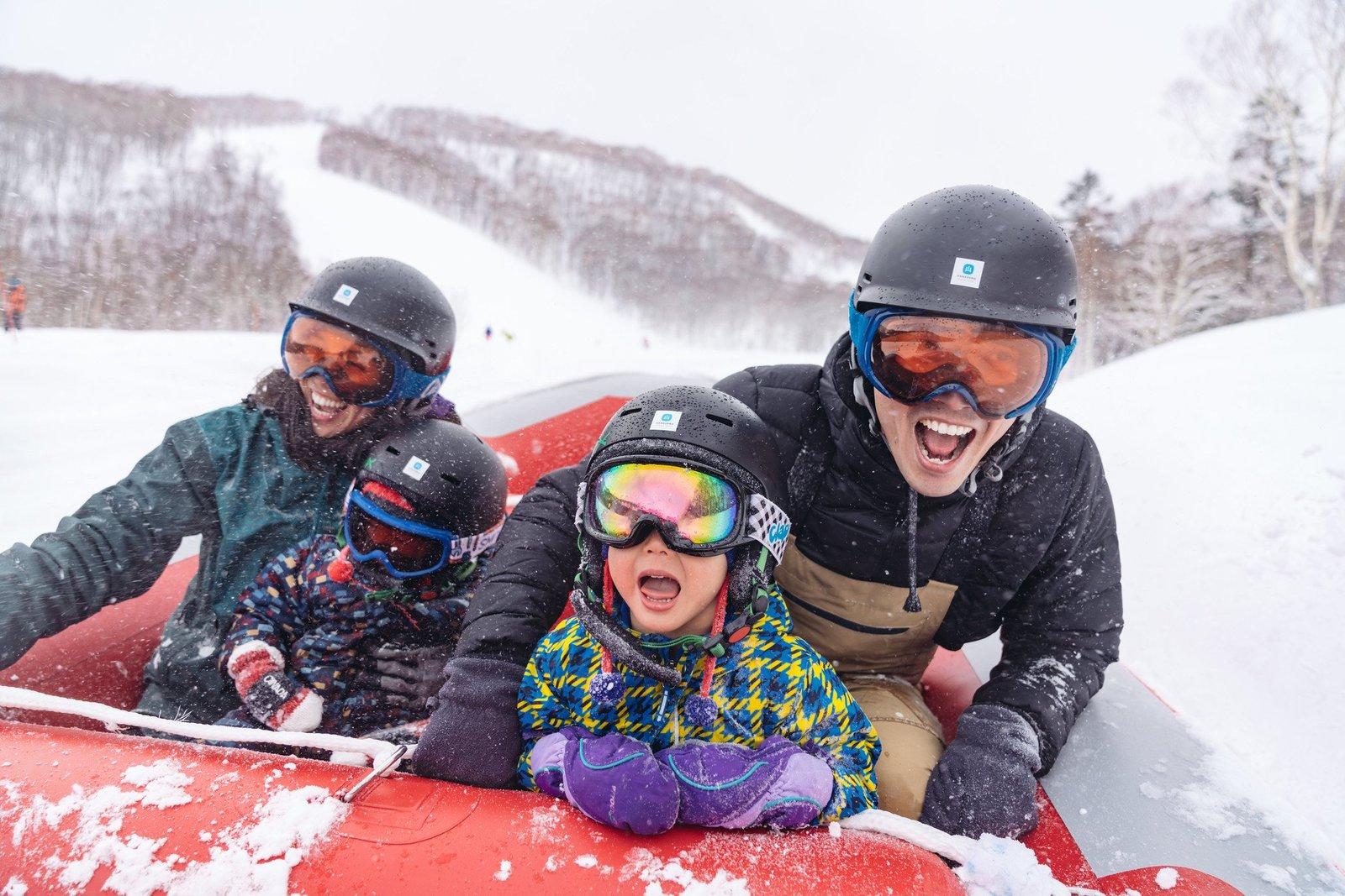 A family having fun on snow rafting tour in Niseko Hanazono Resort, Hokkaido
