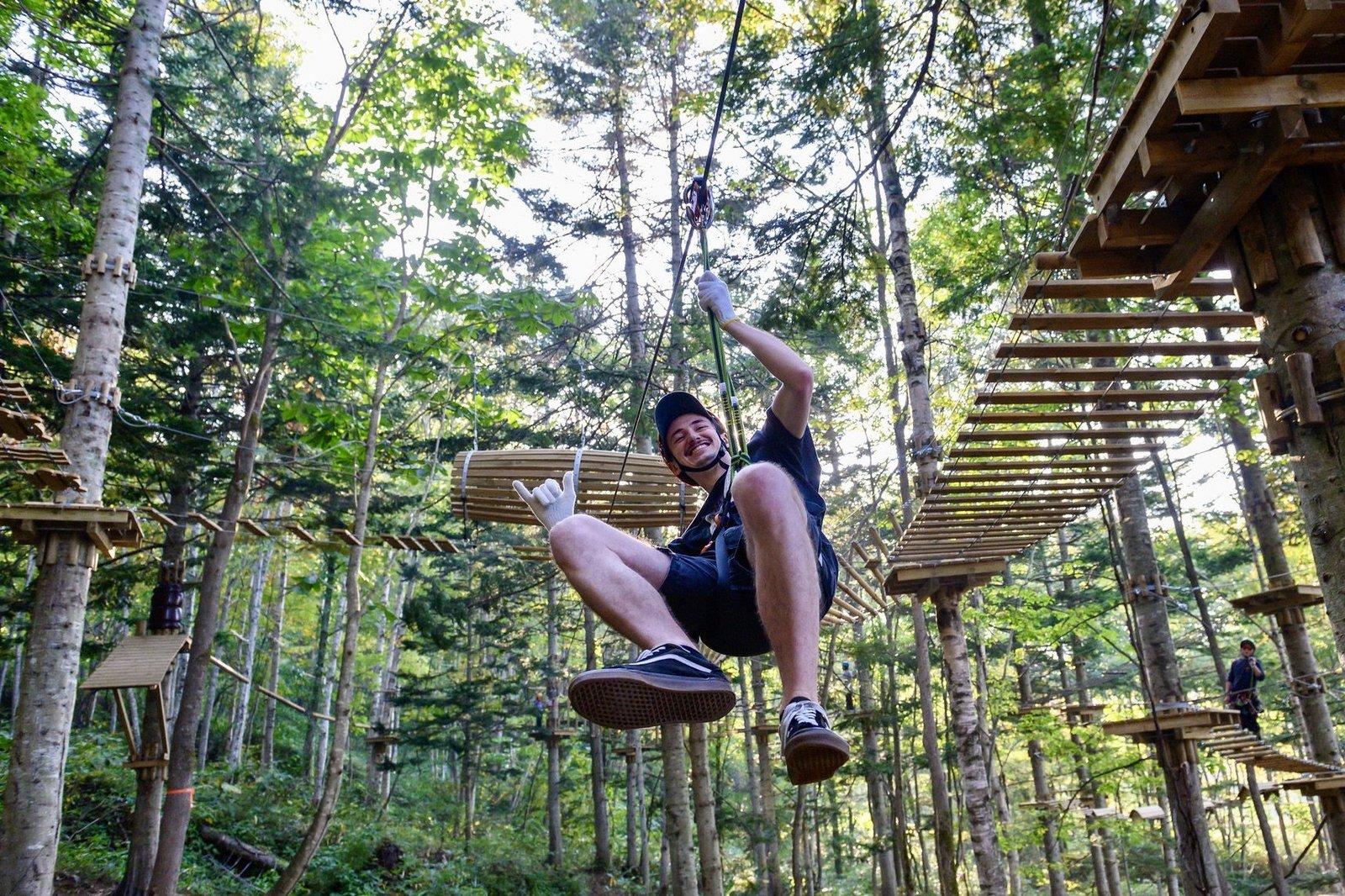 A manl having fun on zipline in Niseko Hanazono resort