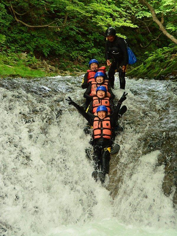 hanazono niseko canyoning water slide