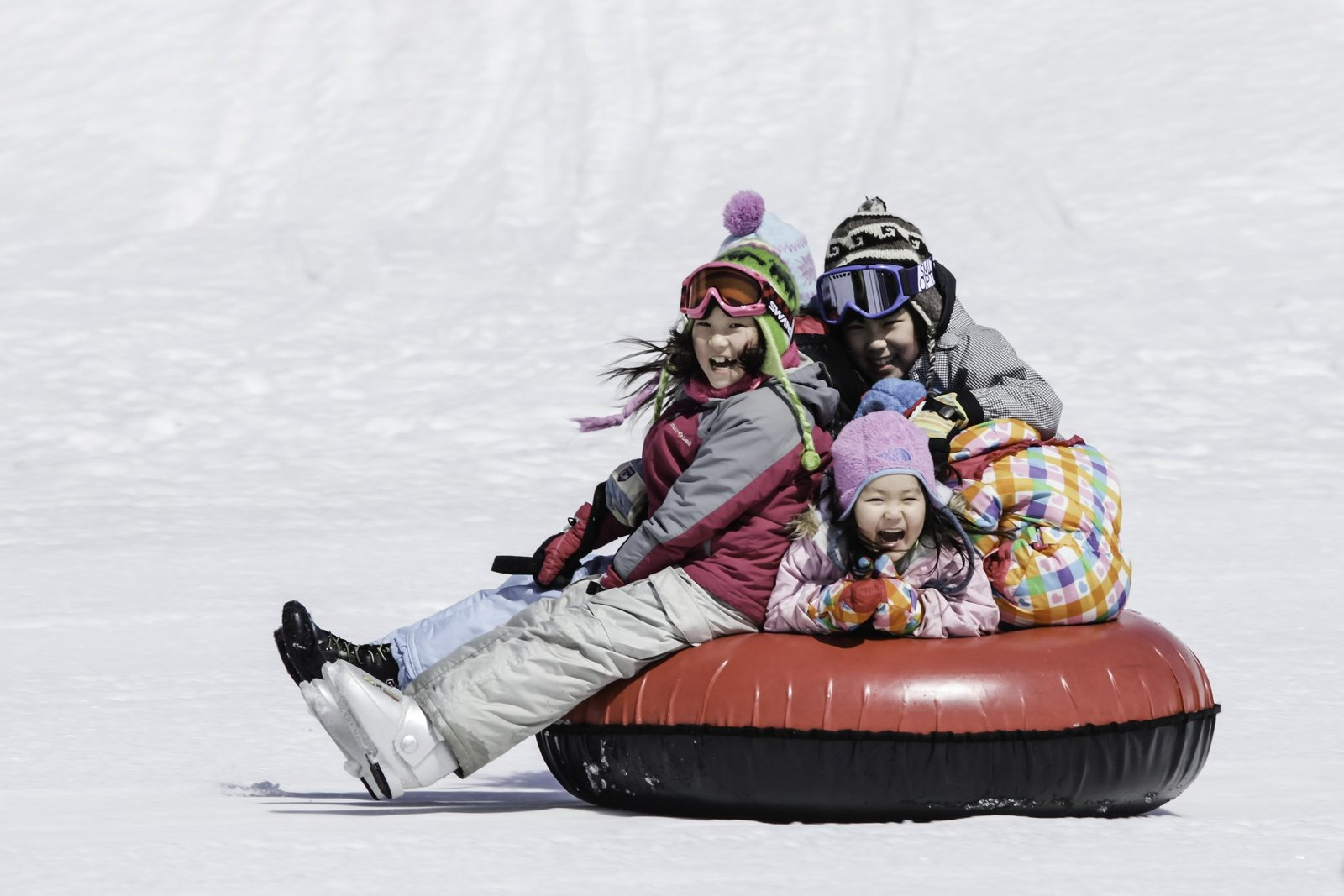 A family having fun in Niseko Hanazono Tube Park