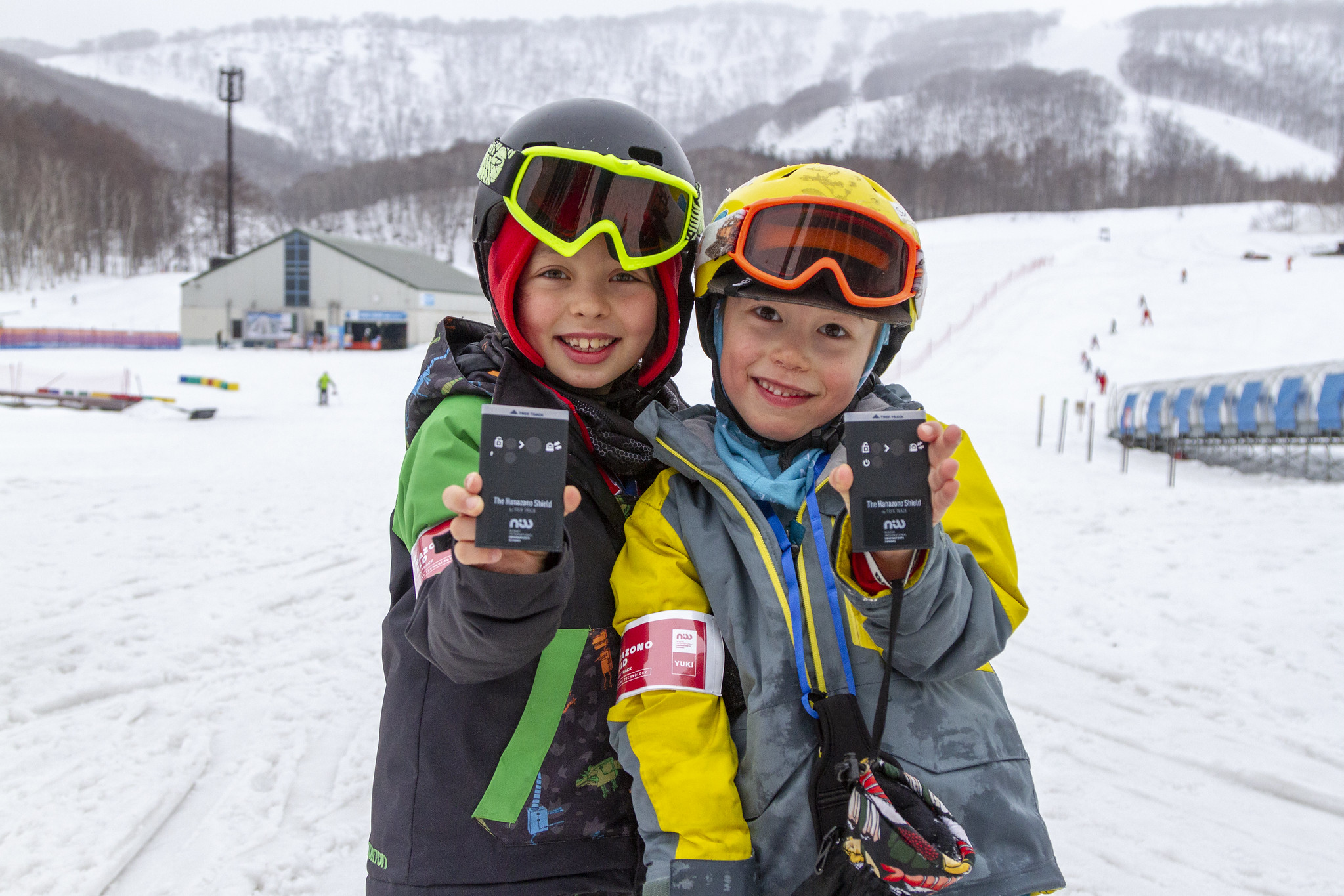 Two children skiing with NISS in Hanazono Resort, Niseko with new Hanazono Shield GPS Tracking Technology.