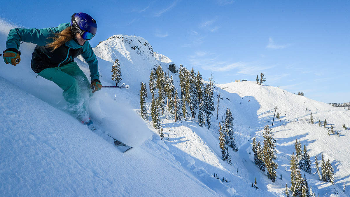 Woman skiing at Squaw Valley Alpine Meadows, California.