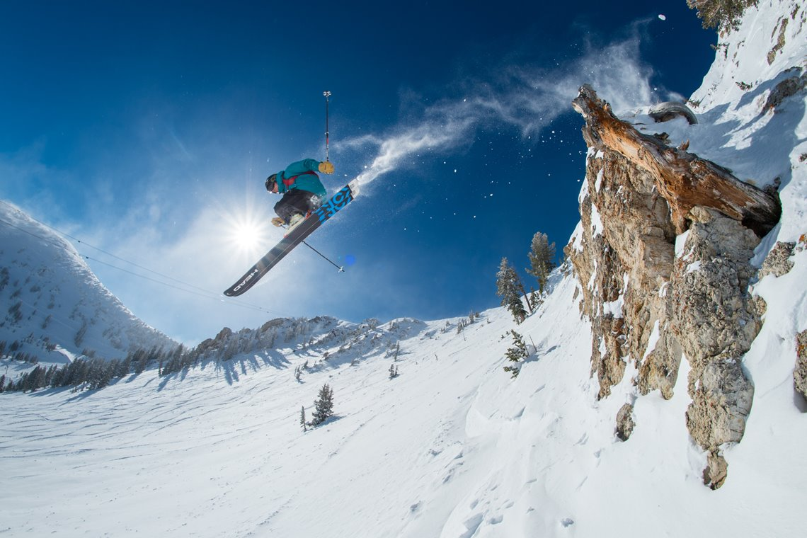 A skier jumping off a cliff in Snowbird Resort, Utah.