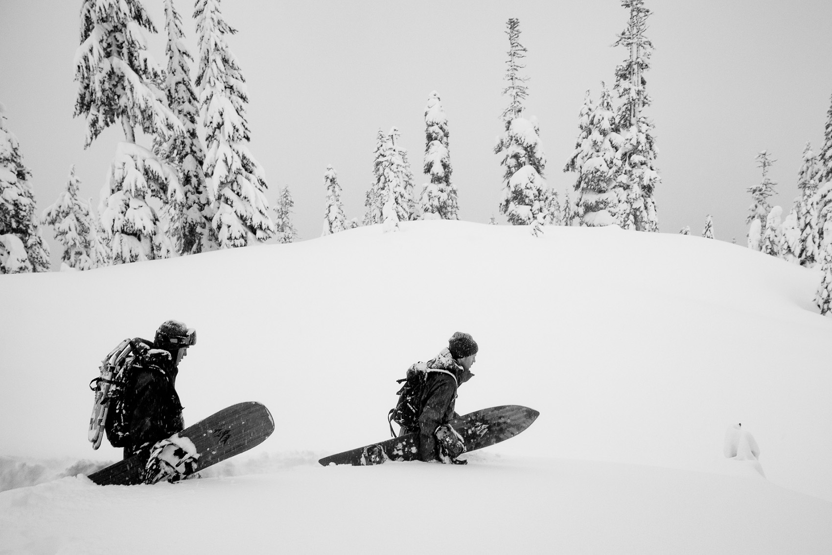 Two snowboarders in deep powder at Mount Baker, Washington.